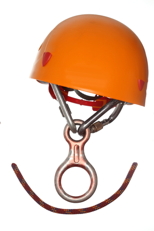 some climbing equipment with helmet on white background