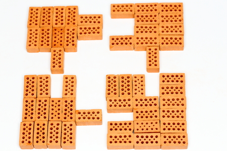 Puzzle with some red bricks on white background