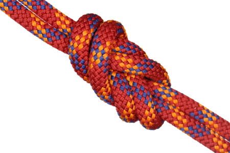 red rope with eight knot on white background Stock Photo