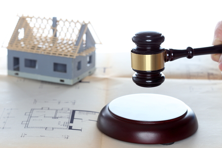 house model for auction with gavel on desk