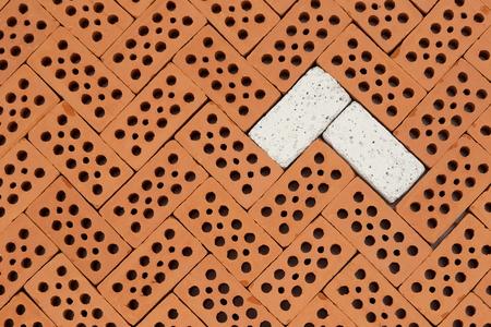 red bricks pattern with some white bricks Stock Photo