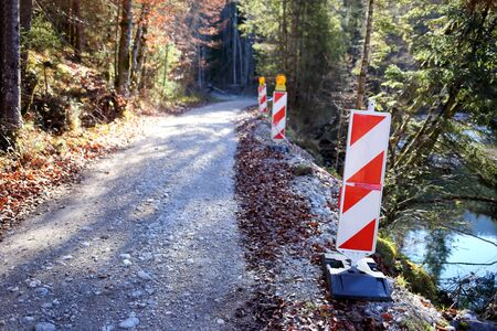 barrier near the crushed rock road in nature Stockfoto