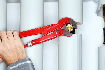 worker with red gripper in hand is mounting