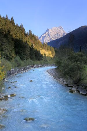 fresh mountain river at sundown in the austrian alps