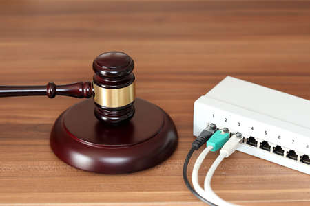 network connection box with gavel symbol on desk