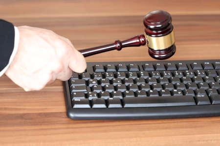 symbolic law with media symbol on a desk