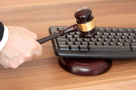 law symbol with keyboard and gavel on a desk
