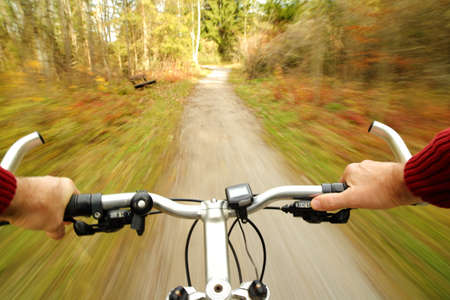 a man with a bicycle is driving fast