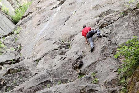 climbing sport man on a sandstone rock wall
