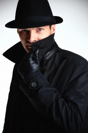 villain: Gangster man in hat