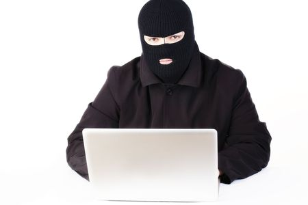 Man stealing data from a laptop Stock Photo - 6049886
