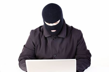 Man stealing data from a laptop Stock Photo - 6049783