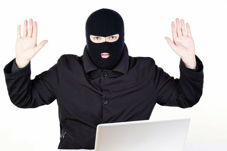 Man stealing data from a laptop Stock Photo - 6049825