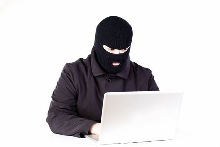 Man stealing data from a laptop Stock Photo - 6049839