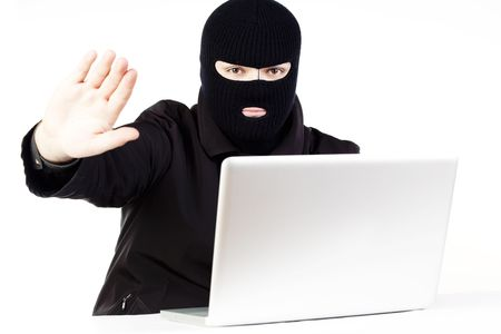 Man stealing data from a laptop Stock Photo - 6049759