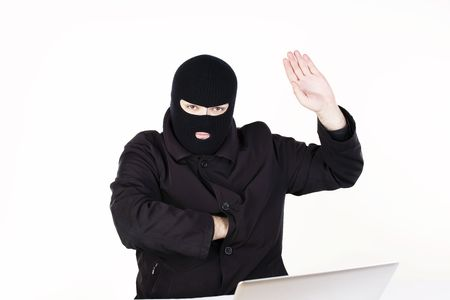 Man stealing data from a laptop Stock Photo - 6049784