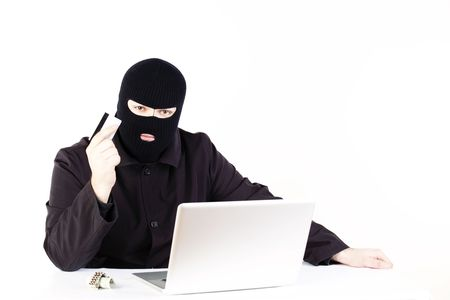 Man stealing data from a laptop photo