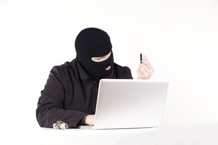 Man stealing data from a laptop Stock Photo - 6049760