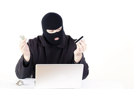 Man stealing data from a laptop Stock Photo - 6049757