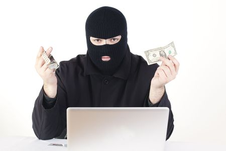 Man stealing data from a laptop Stock Photo - 6049748