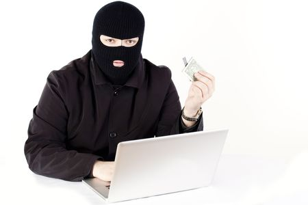 corporate espionage: Man stealing data from a laptop
