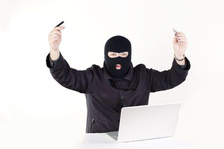 Man stealing data from a laptop Stock Photo - 6049796