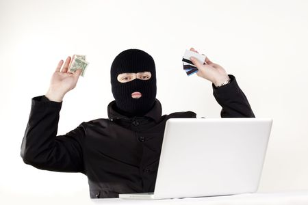 Man stealing data from a laptop Stock Photo - 6049752