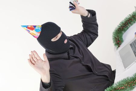 Man stealing data from a laptop Stock Photo - 6049803