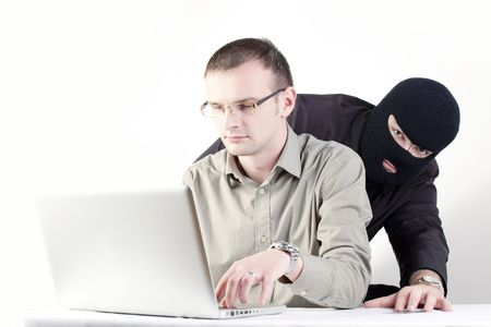 Man shopping online with Man stealing credit card  Stock Photo