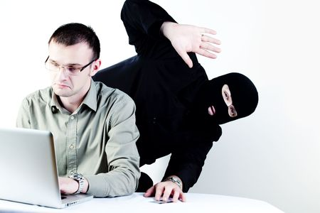 corporate espionage: Man shopping online with Man stealing credit card  Stock Photo