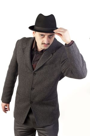 suspicious man: Suspicious man in hat looking at camera Stock Photo