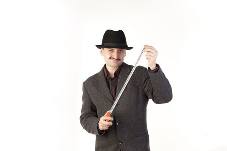 mustaches: Man in hat with ruler