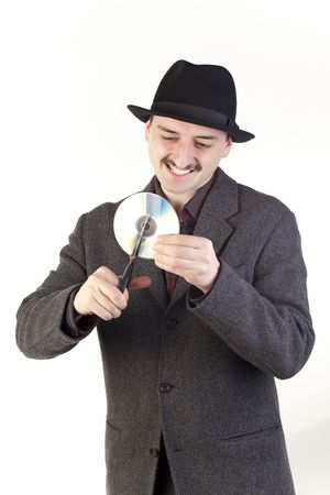 Man in hat cutting a compact disc photo