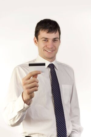creditcards: Businessman holding a credit card