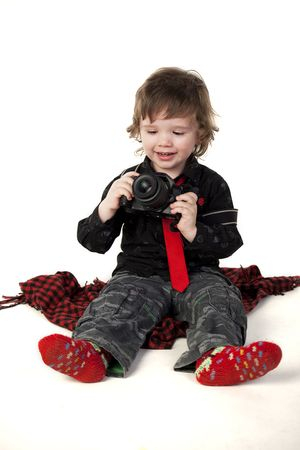 Cute child  with a smiling face holding camera photo