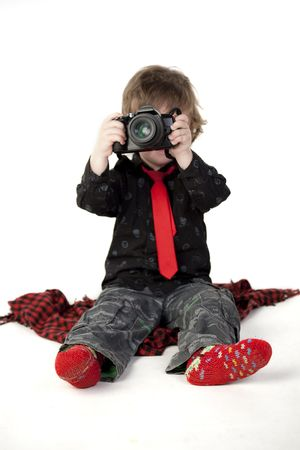 Cute child taking photos on a white background Stock Photo