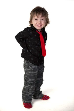 Cute child smiling and hiding his hands back
