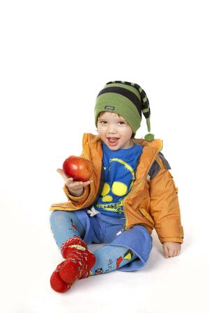 Cute happy child showing his apple Stock Photo - 6743629