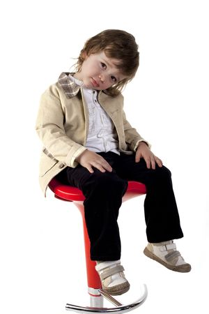 Child posing at camera on a white background Stock Photo - 6815390