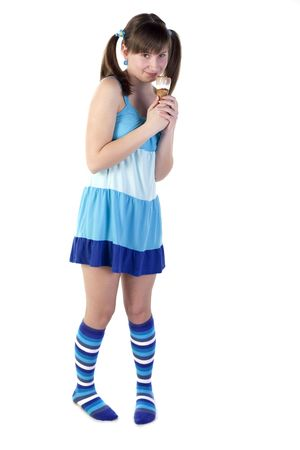 Young lady holding ice cream in a blue dress photo