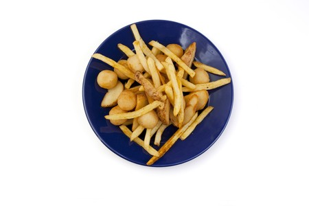 Plate with different types of French fries on a white background Stock Photo - 6852021