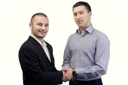 two people with others: Two business people holding each others hands