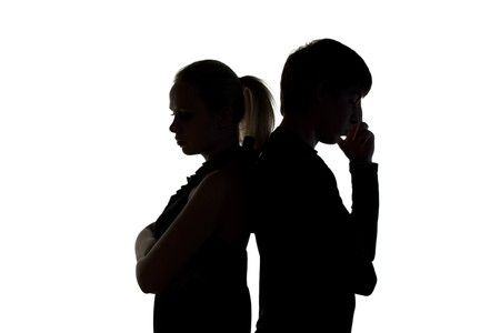 people arguing: Young man and woman on a white background Stock Photo