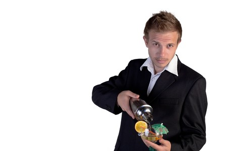 Bartender making cocktail and looking at camera on a white background photo