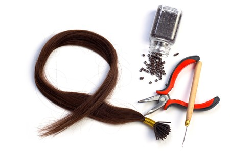 Set of brown hair extension tools Banque d'images - 7345331
