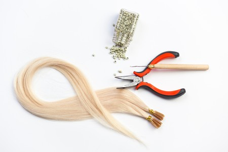 Set of blond hair extension tools