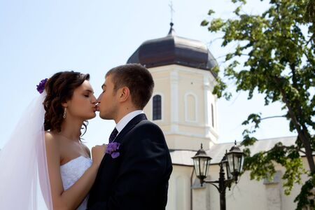 Bride and groom posing and kissing