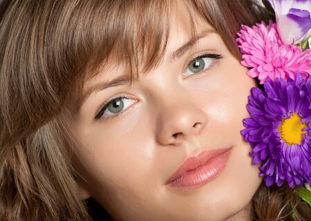 Beautiful face with flower on it photo