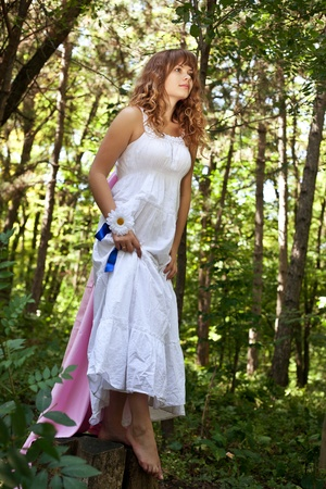Pretty woman posing in forest photo