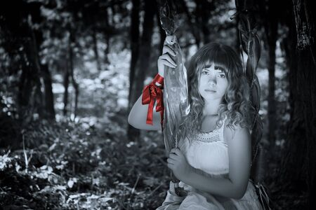 Pretty woman posing in forest Stock Photo